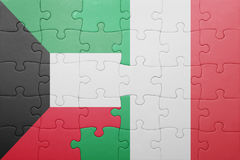 Puzzle with the national flag of italy and kuwait. Concept Royalty Free Stock Image