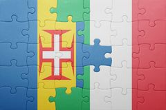 Puzzle with the national flag of italy and madeira Royalty Free Stock Photo
