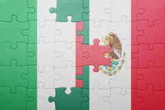 Puzzle with the national flag of italy and mexico. Concept Stock Photography