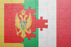 Puzzle with the national flag of italy and montenegro Royalty Free Stock Photography