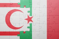 Puzzle with the national flag of italy and northern cyprus Royalty Free Stock Images