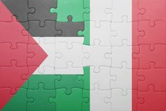 Puzzle with the national flag of italy and palestine Royalty Free Stock Photography