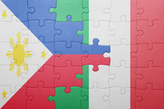Puzzle with the national flag of italy and philippines Stock Image