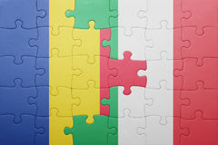 Puzzle with the national flag of italy and romania. Concept Royalty Free Stock Images