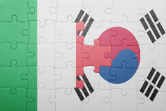 Puzzle with the national flag of italy and south korea. Concept royalty free stock photo