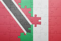 Puzzle with the national flag of italy and trinidad and tobago Stock Photography
