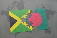 Puzzle with the national flag of jamaica and bangladesh on a world map. Background. 3D illustration royalty free stock photos