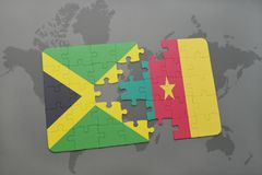 Puzzle with the national flag of jamaica and cameroon on a world map. Background. 3D illustration Royalty Free Stock Images