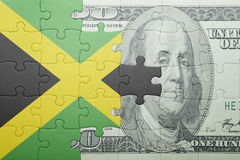 Puzzle with the national flag of jamaica and dollar banknote Royalty Free Stock Photos