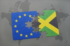 Puzzle with the national flag of jamaica and european union on a world map Stock Photo