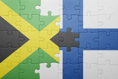 Puzzle with the national flag of jamaica and finland Stock Photography