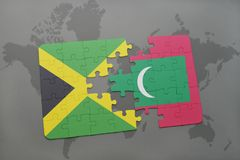 Puzzle with the national flag of jamaica and maldives on a world map. Background. 3D illustration Royalty Free Stock Photography