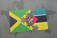 Puzzle with the national flag of jamaica and mozambique on a world map. Background. 3D illustration Royalty Free Stock Photography