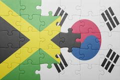 Puzzle with the national flag of jamaica and south korea. Concept stock photography