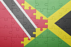 Puzzle with the national flag of jamaica and trinidad and tobago Royalty Free Stock Photos