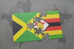 Puzzle with the national flag of jamaica and zimbabwe on a world map. Background. 3D illustration Royalty Free Stock Images