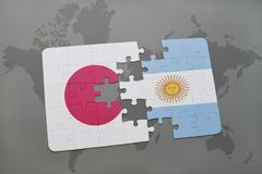 Puzzle with the national flag of japan and argentina on a world map background. Royalty Free Stock Images