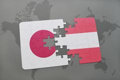 Puzzle with the national flag of japan and austria on a world map background. 3D illustration royalty free stock images