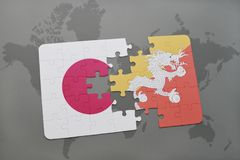 Puzzle with the national flag of japan and bhutan on a world map background. 3D illustration stock photography