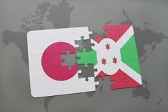Puzzle with the national flag of japan and burundi on a world map background. 3D illustration royalty free stock photo