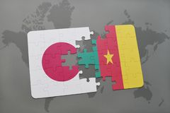 Puzzle with the national flag of japan and cameroon on a world map background. 3D illustration royalty free stock photo