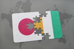 Puzzle with the national flag of japan and cote divoire on a world map background. 3D illustration Stock Image
