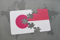 Puzzle with the national flag of japan and indonesia on a world map background. 3D illustration Stock Photos