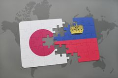 Puzzle with the national flag of japan and liechtenstein on a world map background. Royalty Free Stock Photo