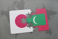 Puzzle with the national flag of japan and maldives on a world map background. 3D illustration Royalty Free Stock Image
