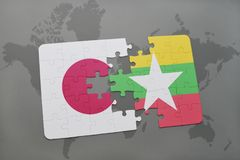 Puzzle with the national flag of japan and myanmar on a world map background. 3D illustration royalty free stock image