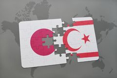 Puzzle with the national flag of japan and northern cyprus on a world map background. Royalty Free Stock Images