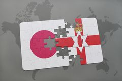 Puzzle with the national flag of japan and northern ireland on a world map background. 3D illustration Stock Photography