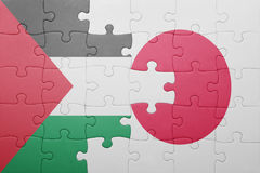 Puzzle with the national flag of japan and palestine. Concept Stock Photo