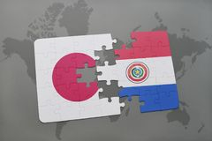 Puzzle with the national flag of japan and paraguay on a world map background. 3D illustration royalty free stock images