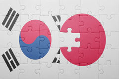 Puzzle with the national flag of japan and south korea. Concept stock image