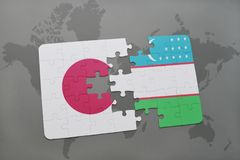 Puzzle with the national flag of japan and uzbekistan on a world map background. 3D illustration stock photo