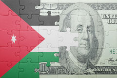 Puzzle with the national flag of jordan and dollar banknote Stock Photo