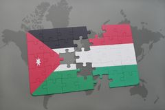 Puzzle with the national flag of jordan and hungary on a world map background. Royalty Free Stock Images