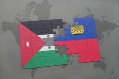 Puzzle with the national flag of jordan and liechtenstein on a world map background. Royalty Free Stock Photos