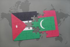 Puzzle with the national flag of jordan and maldives on a world map background. 3D illustration Stock Image