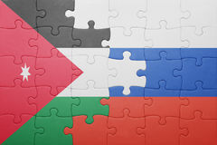 Puzzle with the national flag of jordan and russia Stock Image