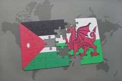 Puzzle with the national flag of jordan and wales on a world map background. 3D illustration Royalty Free Stock Photography