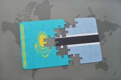 Puzzle with the national flag of kazakhstan and botswana on a world map Stock Photography