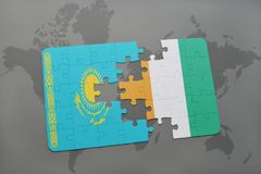 Puzzle with the national flag of kazakhstan and cote divoire on a world map. Background. 3D illustration Royalty Free Stock Image