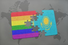 puzzle with the national flag of kazakhstan and gay rainbow flag on a world map background. Stock Images
