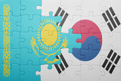 Puzzle with the national flag of kazakhstan and south korea. Concept royalty free stock photography