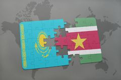 Puzzle with the national flag of kazakhstan and suriname on a world map. Background. 3D illustration Stock Image