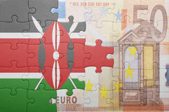 Puzzle with the national flag of kenya and euro banknote. Concept stock photo