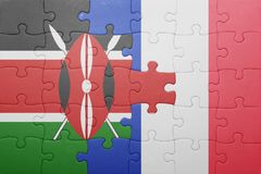 Puzzle with the national flag of kenya and france. Concept royalty free stock photos