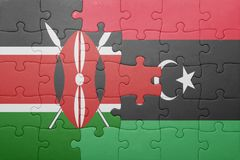 Puzzle with the national flag of kenya and libya. Concept stock image